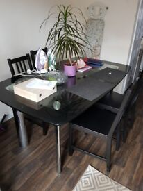 Glass top dining table and 5 chairs