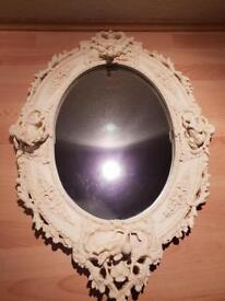Oval cherub mirror