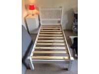 Single Wooden bed frame in white wash colour.