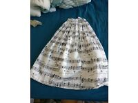 Musical notes pleaded midi skirt