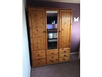 Pine Wardrobe, good condition, double hang space plus shelves and 9 drawers.