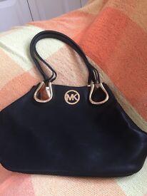 Ladies black MK leather handbag
