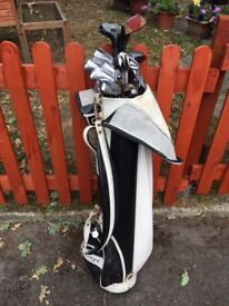 Bag of assorted golf clubs
