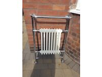 Traditional style towel rail radiator in white.