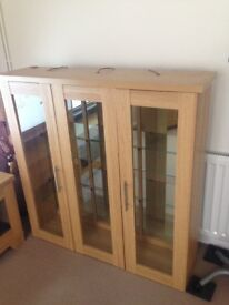 Oak display units, mirrered with glass shelves and lights