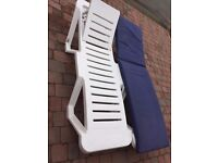 TWO PATIO UPVC SUN LOUNGERS WITH CUSHIONS