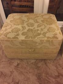 Pouffe foot rest with storage.