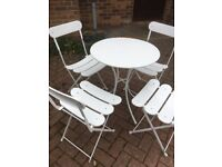 Circular garden table and 4 chairs