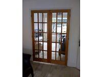 Hardwood glass pane double doors