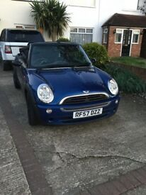 Lovely Mini Convertible 57 reg , blue with black alloys,mirrors and roof