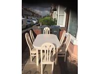 Lovely solid extendable dining table with 6 chairs