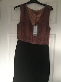 Black dress from Soaked with animal print top
