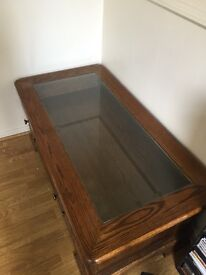 Wooden coffee table with glass top and drawer storage