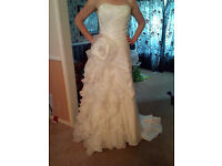 Madeline Gardiner size 10-12 gown with flower and ruffle detail £250 open to offers