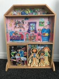 Wooden dolls house with magnetic clothes