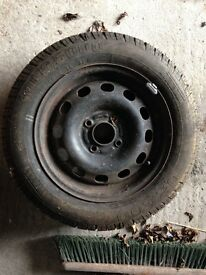 Ford 4 stud steel rim with tyre