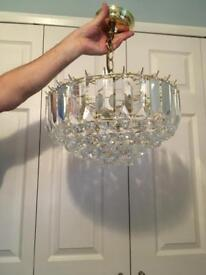 Gold and crystal effect light fitting