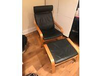Oak veneer and Smidig black leather Ikea Poang armchair and matching footstool.