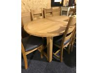 Solid oak oval extendable table and six chairs