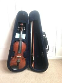 Half size Violin complete with case, bow and accessories.