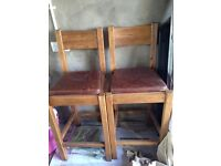 Pair of antique pine solid wood bar stools with leather cushions