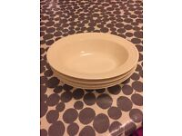 Four Wedgewood vegetable dishes