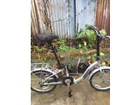 Unisex ammaco folding bike with extra rear box . Offers coincided .