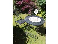 Garden Table and two matching chairs.