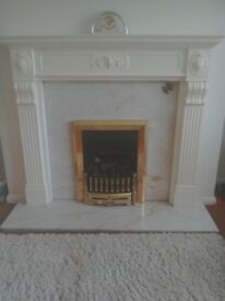 Off White surround Marble back and Base. Coal affect fire. Never needs painting