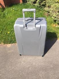 Large hard Revolution suitcase. Never used!