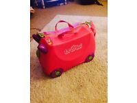 Pink ride on trunki