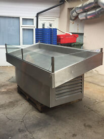 Large stainless steel refrigerated serving counter/display.