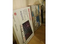 2 brand new sharp smart tvs 40 inches both. For both of them the price is 450 for just the one 220