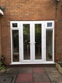 French doors with 2 top openers upvc. Pristine condition 2 years old. Changing due to building works