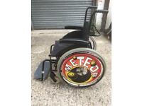 Compact lightweight rigid but folding wheelchair