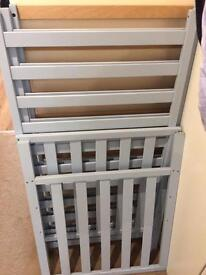 Baby blue mothercare cot