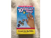 Opti-art rings.