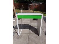 Ikea desk with green draw front .