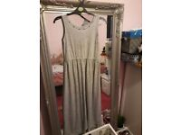 Long dress. Jersey/cotton material. Grey colour with studs on neck area. New. Age 11-12. Only £5.