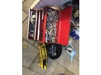Red tool box with job lot of tools and anything in the cupboard in picture