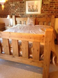 Very chunky Wood Kingsize bed frame with matching bedside tables