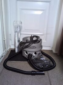 Numatic Henry Commercial Bagged Vacuum Cleaner C/W Brand New Tools And Bags.