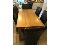 Solid oak dining room table and 6 xbrown leather chairs