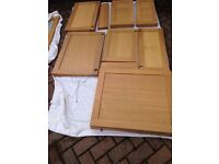 Kitchen wall unit doors with glass fronted doors and drawer fronts make Tidaholm Oak Doors (Ikea)