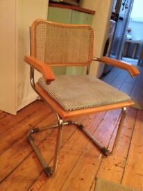 2 armed Marcel Breuer dining chairs, reupholstered in blue/white striped material. Classic design.