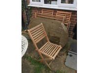 Hardwood teak garden table and 4 chairs.