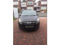 Vauxhall Corsa 1.2 black. Little chips at front of bonnet.