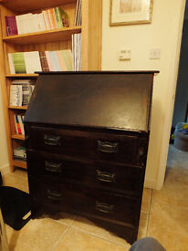 Dark wood traditional bureau with drawers and work flap