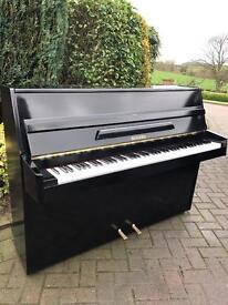 Rogers black upright piano