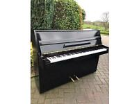 Rogers black upright piano